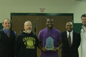 Imoh Udoh accepts Scholar Athlete of the Month award from 99.9 The Fan. Meredith Norman/ The Omniscient.