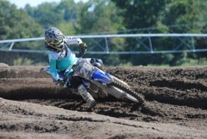 Junior Kyle Jones leans into a turn mid-race at the Pro Shootout at Hog Heaven in Godwin, N.C. Photo courtesy of Tammie Jones