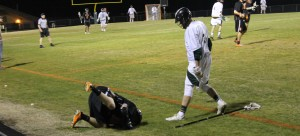 Junior Cole Walker stands over a fallen Orange player. Walker received a penalty for taunting. Skyler Waugh/The Omniscient