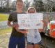Hayden Griffin promposes to Victoria Goin with a sign during track practice.